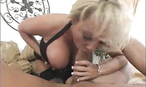 Once delicious Milan with giant tits grips his pipe she won't let go