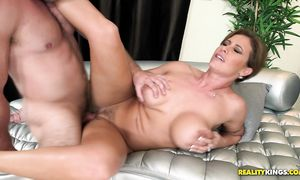 Racy brown-haired Eva Notty with big tits takes a huge dangler in her wet fanny