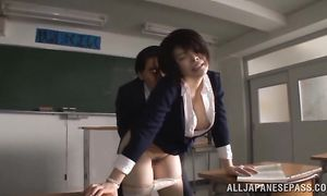 Wanton Rin Ogawa with giant tits has her pierced love tunnel doggy styled