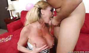 Curvaceous busty golden-haired babe Taylor Wane loves being fucked hard and fast
