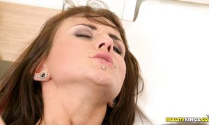 Astonishing dark-haired Roxy Taggart is sucking a large hard lovestick and moaning from pleasure while getting fucked hard