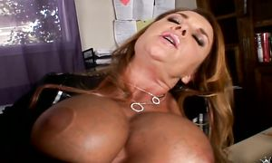 Salacious brown-haired girl Janet Mason with giant tits rubs her twat in leather boots and lingerie