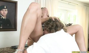 Passionate blond maiden Randi Lane with firm tits rides a pulsating pecker